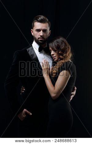portrait of fashion couple on black background