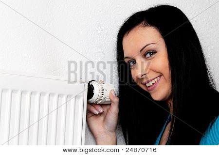 woman with a heater and thermostat