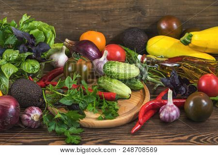 Many Delicious Fresh Juicy Colorful Summer Vegetables And Herbs On Dark Wooden Background. Close Up,