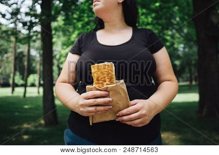 Unhealthy Fattening Food, High-calorie Snack, Eating On The Go, Take-out Meals. Overweight Woman Eat
