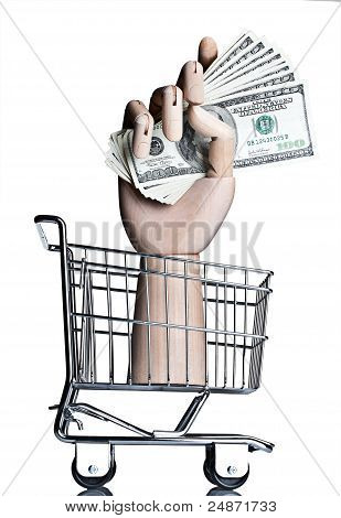 Manikin hand in a miniature shopping cart, holding money