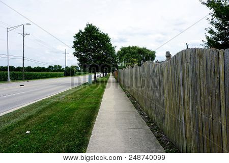 A High Stockade Fence, Along Theodore Street, Furnishes Privacy To Residents Of The Pheasant Landing