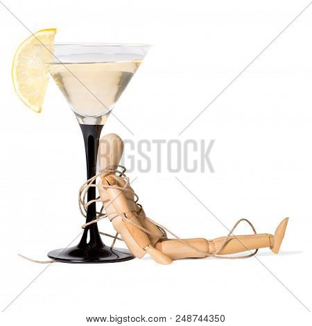 Wooden Mannikin Strapped To The Glass Of Vermouth. Concept Of Drunkenness, Alcohol Abuse. Isolated O