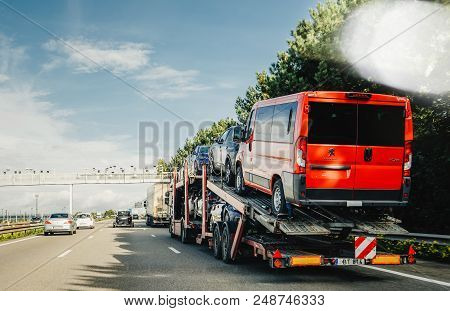 Munchen, Germany - Oct 7, 2018: Large Truck Carrying New Peugeot Vans And Cars On German Highway Aut