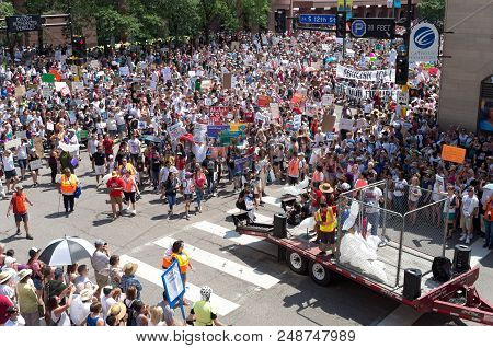 Mpls, Mn/usa - June 30, 2018: Protesters March In The Streets To Support The National Rally Families