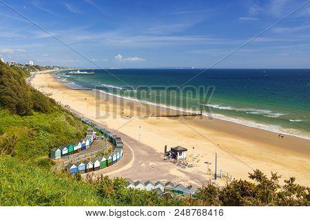 Sunshine Illuminates Golden Beaches And Blue-green Seas Along The Dorset Coast At Middle Chine Betwe
