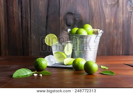 Lime Juice Or Lime Lemonade Or Green Lemon With Lemon Tank On Wooden Table.