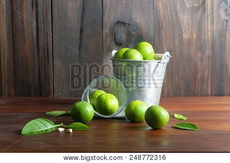 Lime Or Green Lemon Tank And Lime Glass With Leaf And Blossom On Wooden Table.sour Fruit Or Raw Food