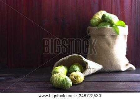 Noni Fruit In A Sack On The Table.