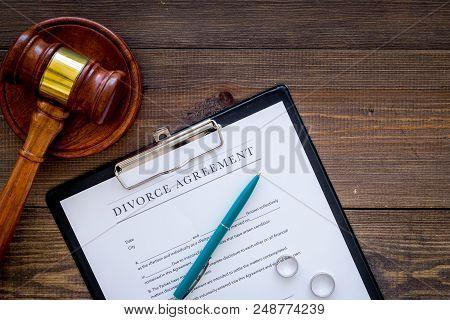 Divorce Court Case. Divorce Agreement Near Wedding Rings And Judge Gavel On Dark Wooden Background T