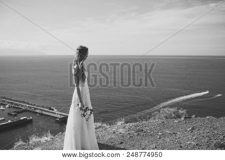 Honeymoon Trip. Pretty Girl Or Beautiful Bride, Young, Sexy Woman In White Dress With Wedding Bouque