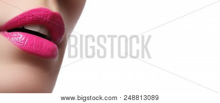 Close-up Of Woman's Lips With Bright Fashion Pink Glossy Makeup
