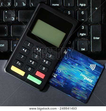 Close-up Bank Card And Payment Device Lying On Keyboard, Top View. Concept Of Internet Crime, Hackin