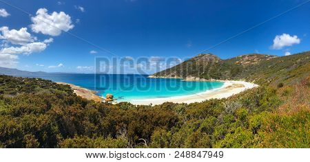 Panoramic view of Little Beach with white powdery sand, beautiful sapphire blue shade of sea water, Mt Gardner at Two peoples Bay conservation reserve in Albany, Western Australia.