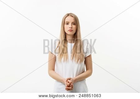 Pretty Female With Fair Hair, Dressed Casually, Looking With Satisfaction At Camera, Being Happy. St