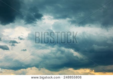 Dramatic stormy sky with heavy clouds, may be used as background