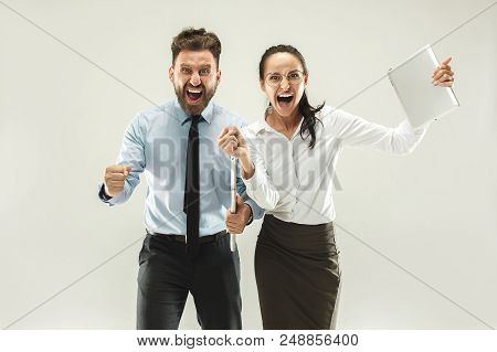 We Won. Winning Success Happy Woman And Man Celebrating Being A Winners. Dynamic Image Of Caucasian