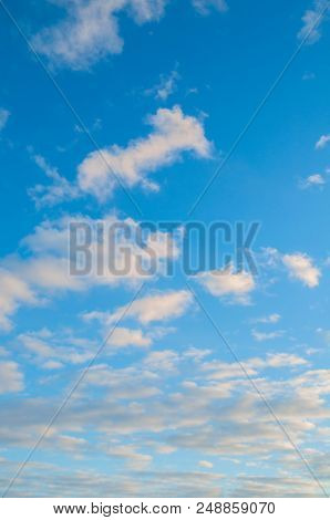 Blue Sky Sunset Landscape With Dramatic Clouds Lit By Evening Sunlight - Colorful Evening Sky View.