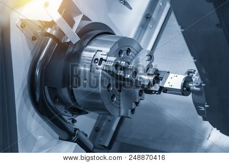 The Cnc Lathe Or Turning Machine Use The Robot Arm Setting The Work Pieces.the Industrial 4.0 Concep