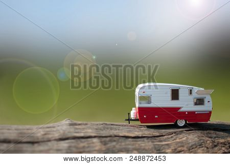 Caravan Trailer With View Of Summer Countryside In The Background