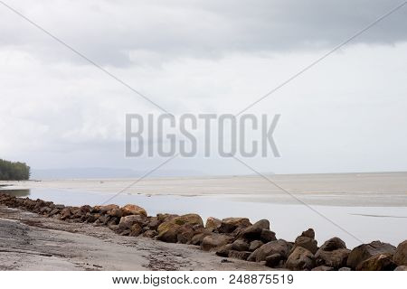 Sandy Beach With Wall Rock Duty Low Tide Windy Effect To Fine Sand Reflect Under Sky At Trat Provinc