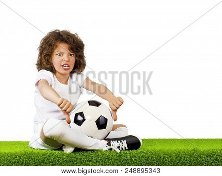 I Do Not Like This. Bad Football, Judge. Little Beautiful Boy In Uniform Sitting On Grass With Socce