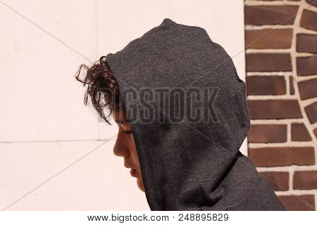 Sad Troubled Hispanic 13 Years Old School Boy Teenager Wearing A Hoodie Posing Outdoor - Close Up St