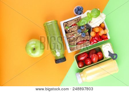 Lunch Box With Healthy Food And Juice From Fresh Berries. Toast And Apple. Books For School And Gree