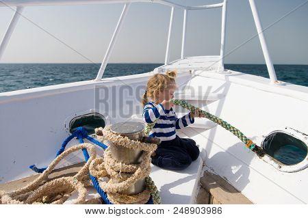 Little Helper. Boy Adorable Sailor Striped Shirt Yacht Travel Around World. Child Cute Sailor Help W