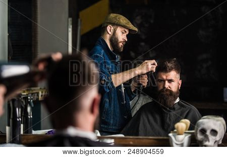 Hipster Bearded Client Getting Hairstyle. Barber With Hairdryer Works On Hairstyle For Bearded Man,