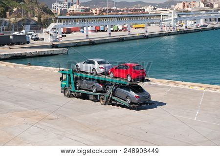 Barcelona, Spain - March 30, 2016: Tow Truck Carry Seat And Mercedes Cars In Sea Port. Auto Export A