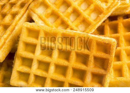 Close-up Of Homemade Fresh Brown Waffles. View To Stacked Wafles. Bakery And Food Backgrounds.