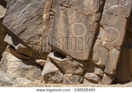 Flinders Ranges, South Australia, Australia - March 15, 2018: Aboriginal Circular Engravings Within