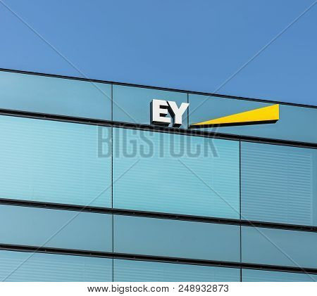 Zurich, Switzerland - July 8, 2018: Upper Part Of A Building Bearing The Sign Of Ernst & Young, Whic