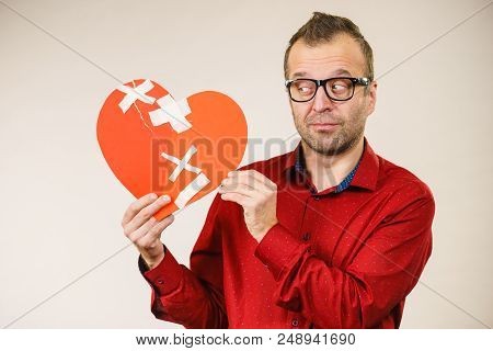 Bad Relationships, Breaking Up, Sadness Emotions Concept. Sad Serious Thinking Adult Man Holding Bro