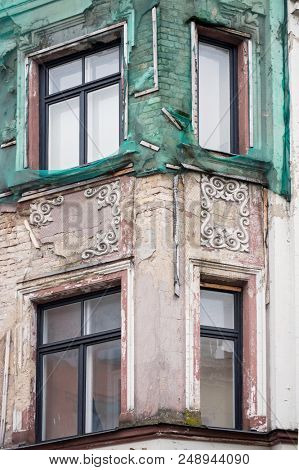Beautiful historic building in need of restoration. Art nouveau (Jugendstil) architecture sample. Riga, Latvia, Europe.  poster