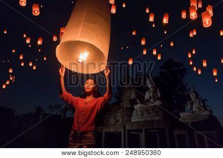 Women Release Khom Loi, The Sky Lanterns During Yi Peng Or Loi Krathong Festival In Chiang Mai, Thai
