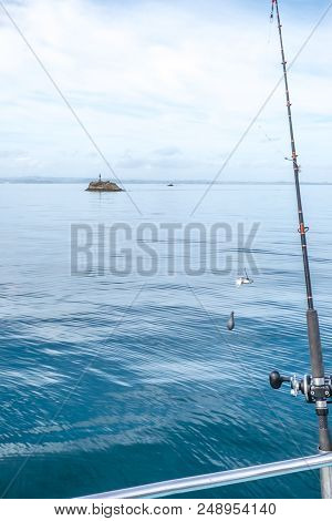 Fishing Rod With Bait, Hook And Sinker With Navigation Buoy In Background In Far North District, Nor