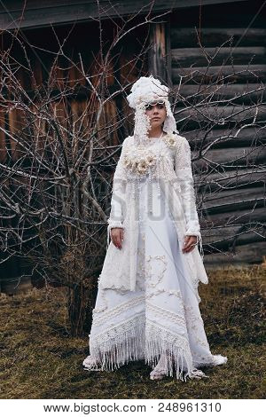 Girl New Ethnic Russian Fashion Vogue Creative Clothes Pose Near Old House, White Dress And Hat, Eth