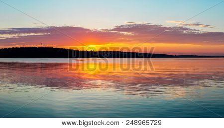 Gorgeous Orange Teal Sunset On Huge Calm Lake