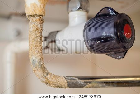Limescale. Hard Water Plumbing Damage On A Boiler Pipe. Calcium Carbonate Build Up On A Badly Mainta