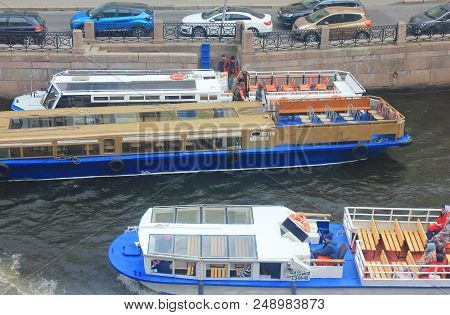 St. Petersburg, Russia - June 18, 2018: Cruise Tour Boats At Small River Canal Water. Outdoor View W