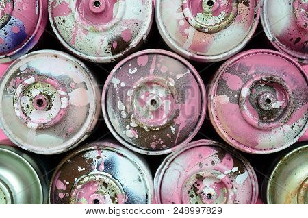 A Few Used Spray Cans With Pink Paint Drips Lie On Texture Background Of Fashion Pastel Pink Color P