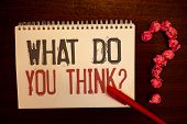 Handwriting text What Do You Think Question. Concept meaning Opinion Sentiments Comment Judgment Conviction Reddish paper balls structures question mark red pen notebook browny desk poster
