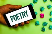 Conceptual hand writing showing Poetry. Business photo text Literary work Expression of feelings ideas with rhythm Poems writing Text message smart screen mobile handset crumpled small balls poster