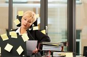 woman having stress in the office - multitasking and time management poster