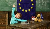Idea concept. Little child got creative idea in classroom with eu flag. Genius child create idea with innovative technology. Idea and creativity. For the future we prepare. poster