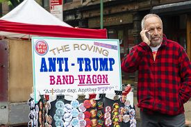 New York, Usa - May 20, 2018: Anti-trump Pins For Sale At A Stall In New York City. Protests Against