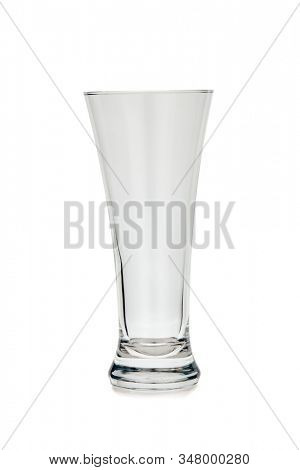 Empty clear beer glass isolated on white background. Pilsner glass