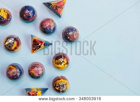 Colorful Trendy Blue, Red, Yellow Chocolate Pralines On Pastel Blue Background. Modern Chocolate Des